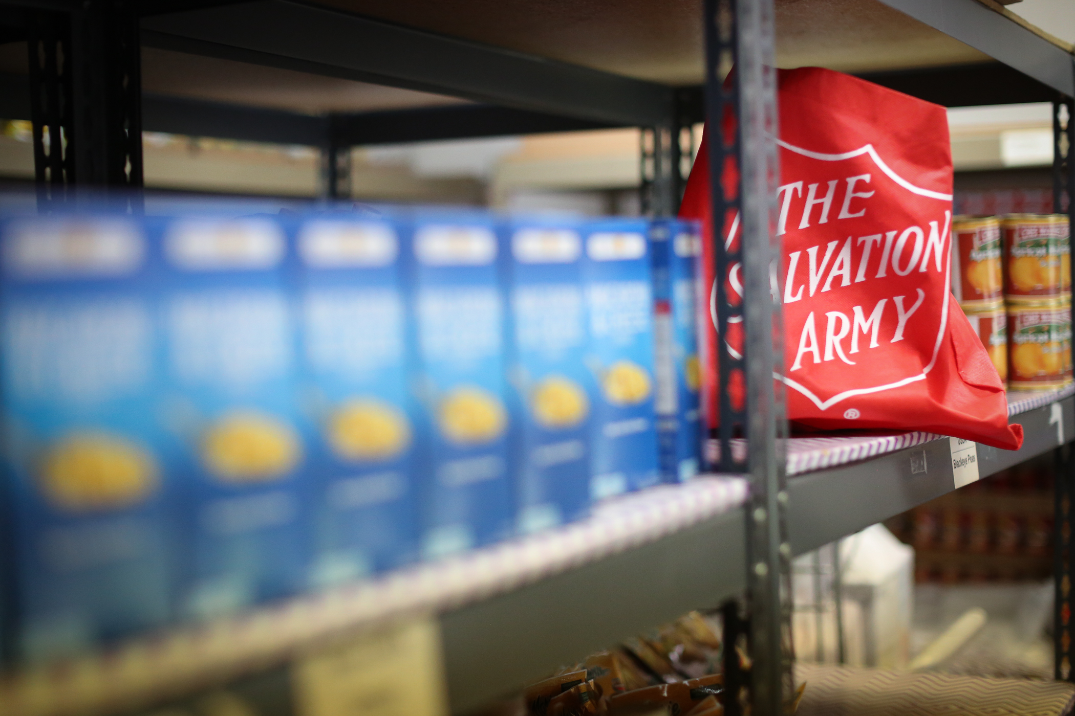 Salvation Army bag on shelf in food pantry